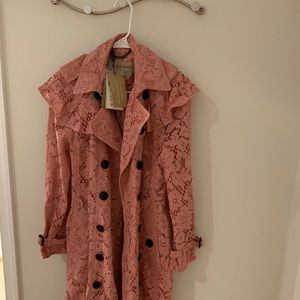 Burberry pink lace trench coat.